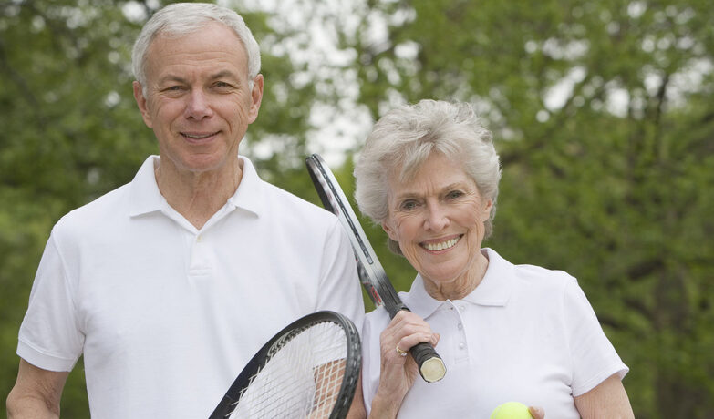 Old couple playing tennis