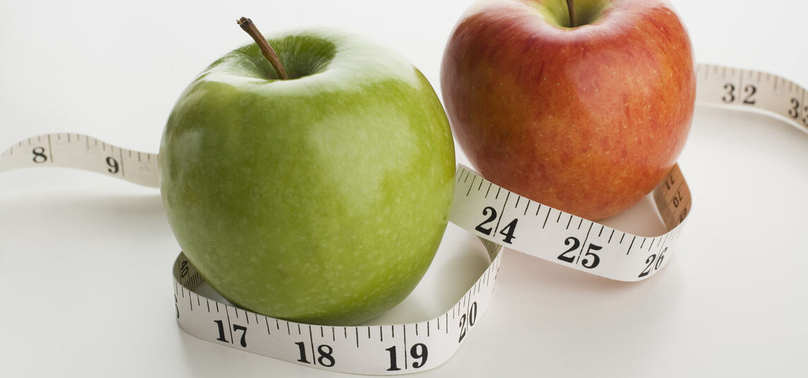 Green and Red Apple with Measuring Tape